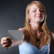 Young woman with a business card — Stock Photo #13627196