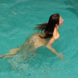 Nude woman swims in cooling pond — Stock Photo