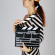 Model in stripy dress and cap at shooting — Stok fotoğraf