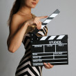 Model in stripy dress and cap at shooting — Stock Photo