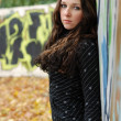 Teenage sad girl near graffiti wall — Stockfoto