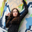 Teenage girl near graffiti wall — Stock Photo