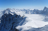 Snow slope with mountain-skiers, the Alps — Stock Photo