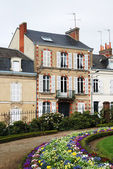 Smart house and bright flower-bed in french town — Foto de Stock