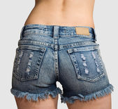 Hips of girl in blue short shorts — Stock Photo