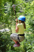 Preteen girl zipping down — Stock Photo