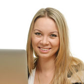 Close-up of a happy young woman in front of the laptop — Stock Photo