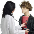 Foto Stock: Doctor auscultating mannikin