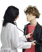 A doctor auscultating the mannikin — Stock Photo