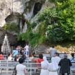 Believers near the Grotto in Lourdes — Stock Photo