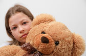 Close-up of the preteen girl with her teddy bear — Stock Photo