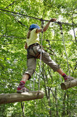 Girl at the rope course — Stock Photo