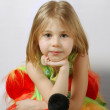Attentive scrutiny of little blond girl — Stock Photo