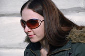 Teenager long-haired girl in brown sunglasses, half face — Stock Photo