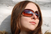 Maidenly face in sunglasses, close-up — Stock Photo