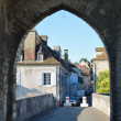 French town through the ancient stone arch — Stock Photo