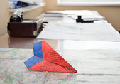Paper plane on the aerial map — Stock Photo