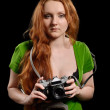 Pretty woman with a vintage camera — Stock Photo