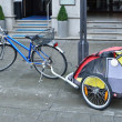 City bicycle meshed with the pram — Stock Photo