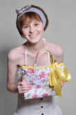 A happy teen with a floral bag — Stock Photo