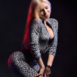 Blonde in catsuit dappled — Stock Photo #30391141