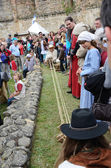 Making a cord at the festival of historical reenactment — Stock Photo