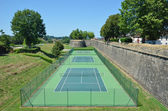 Tennis courts near the ancient wall — Stok fotoğraf