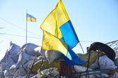 Ukrainian flag on the barricade — Stock Photo