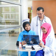 Confident Muslim doctor busy conversation at hospital — Stock Photo #31192741