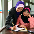 Beautiful young muslim businesswoman sharing info — Foto Stock