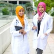 Stock Photo: Young medical student asian muslim woman in head scarf