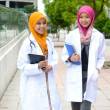 Young medical student asian muslim woman in head scarf  — Стоковая фотография