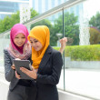 Young asian muslim businesswomen in head scarf smile with mobile laptop  — Stock Photo
