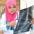 Confident Muslim doctor make analysis x-ray — Stock Photo #31376861