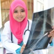 Confident Muslim doctor make analysis x-ray — Stock Photo