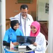 Confident Muslim doctor busy conversation at hospital — Stock Photo #31377019