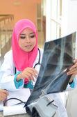 Confident Muslim doctor make analysis x-ray — Stock Photo
