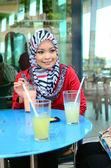 Beautiful young muslim businesswoman sharing info — Stock Photo
