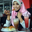 Close-up portrait of beautiful young Asian Muslim woman at cafe with lovely smiles  — Stock Photo