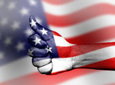 Hand with thumb up gesture in colored usa national flag — Стоковое фото