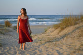 Beautiful young woman walking back from the beach — Stock Photo