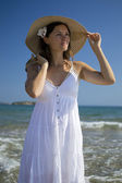Beautiful elegant young woman on the beach — Stock Photo