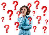 Girl among questions — Stock Photo