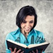 Girl with book — Stock Photo #23370234