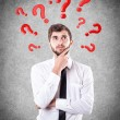 Questions round a head — Stock Photo