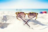 Glasses on a beach — Stock Photo