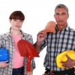 Roofer and his female helper - Stock Photo