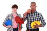 Roofer and his female helper — Stock Photo