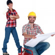 Laborers with a tool box — Stock Photo
