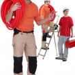 Three plumbers — Stock Photo #13754886